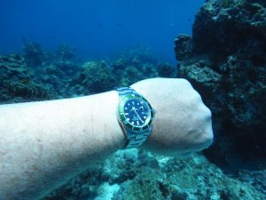 diving in the sea with rolex