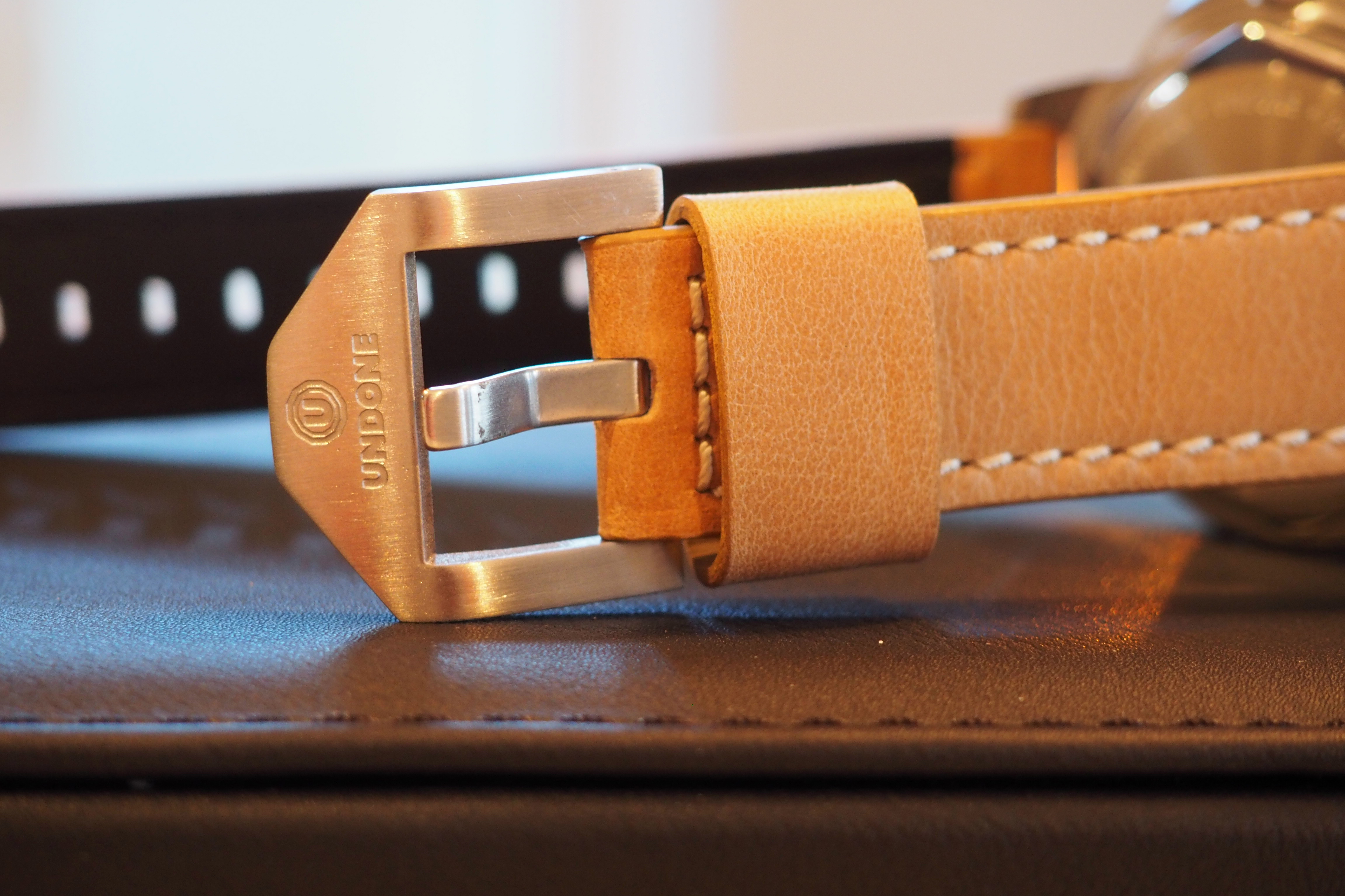 Buckle and leather strap