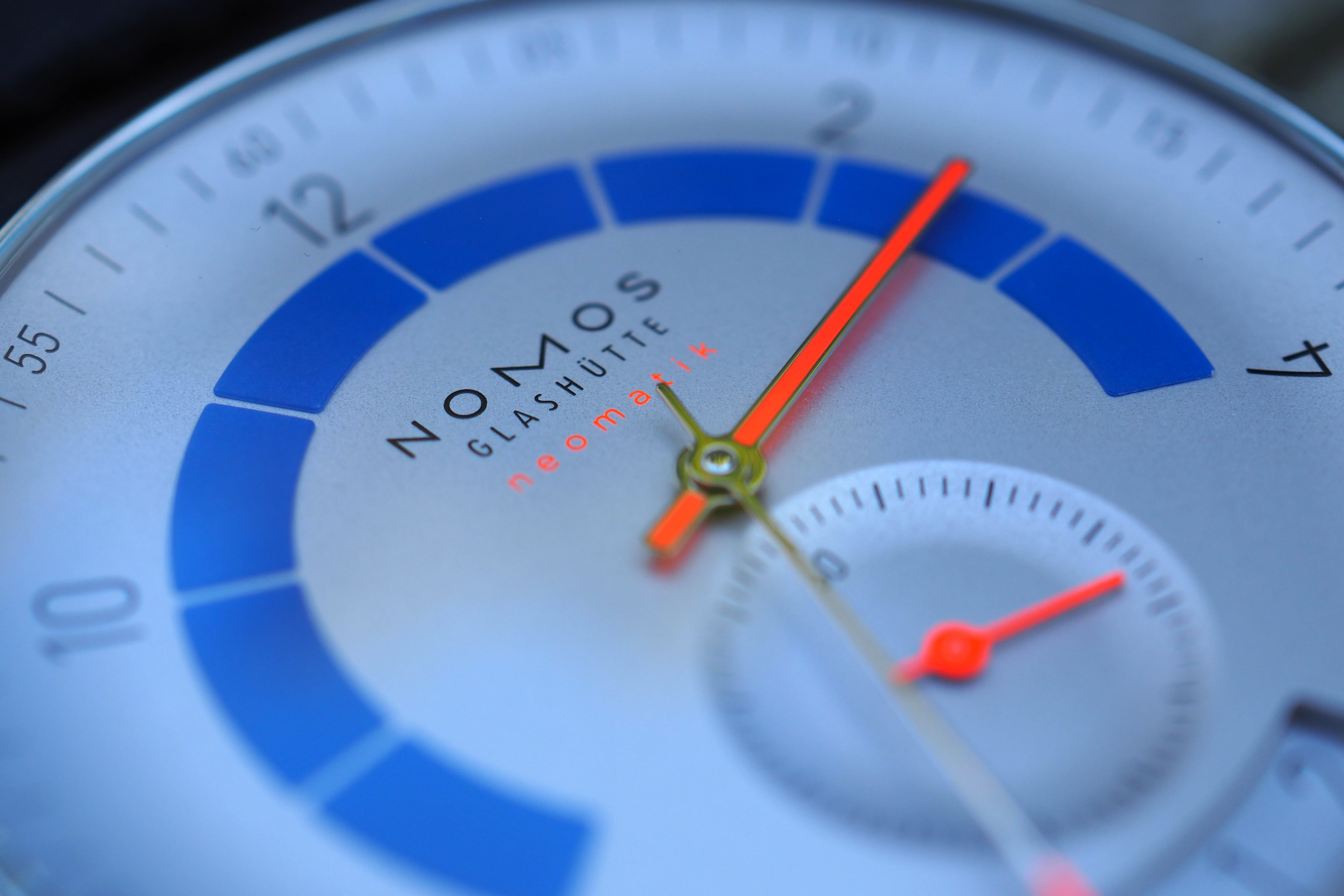 Dial, indices, and hands close up macro