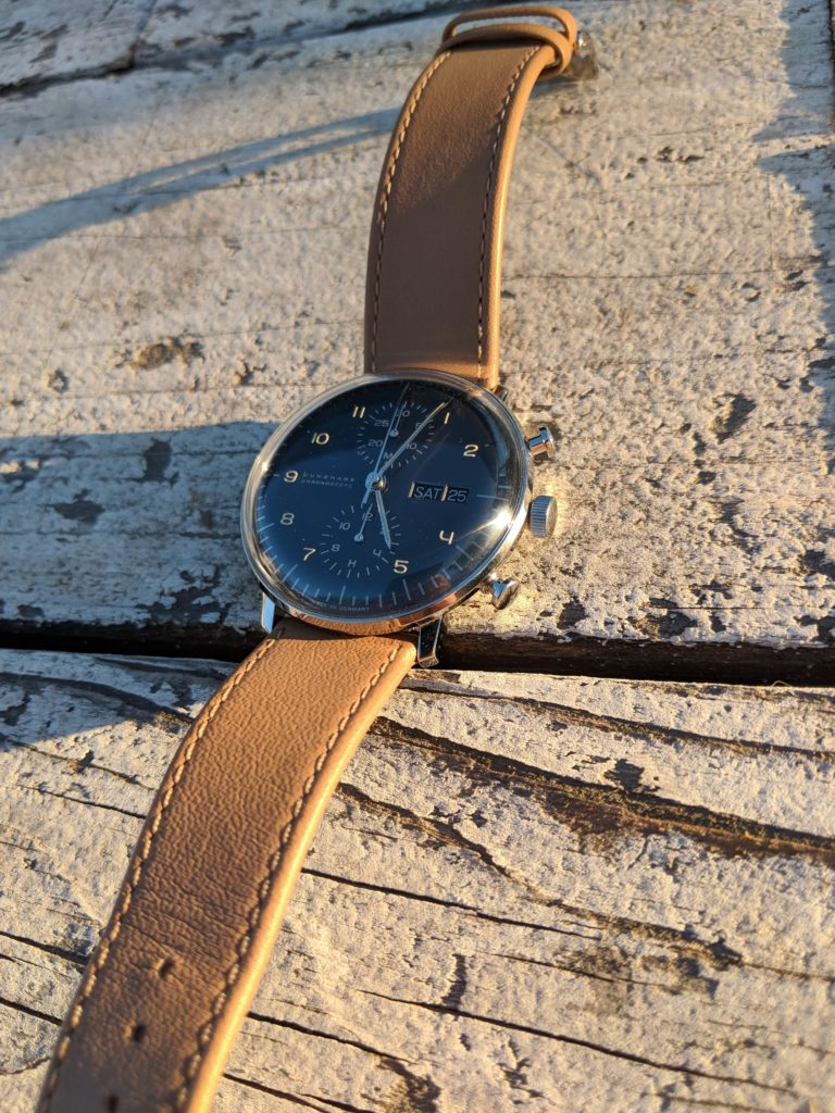 Leather band and deep shade of dial