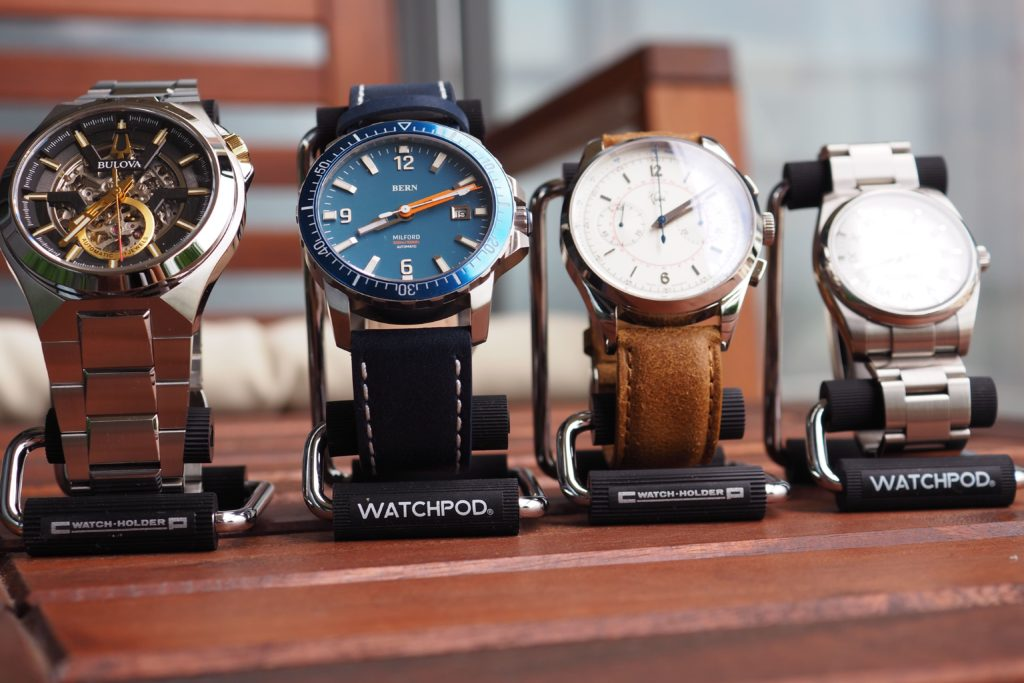 Watch stands with watches on