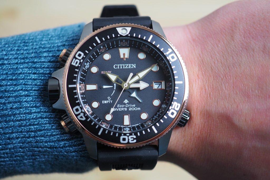 Aqualand dial close up on wrist