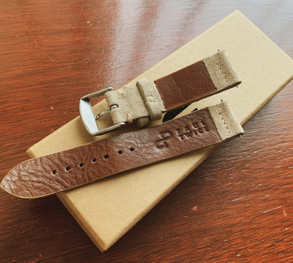 Under side of watch strap with logo