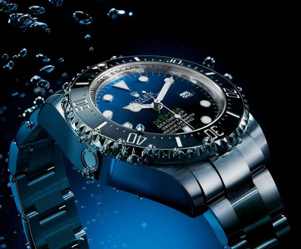 gas bubbles coming from watch under water
