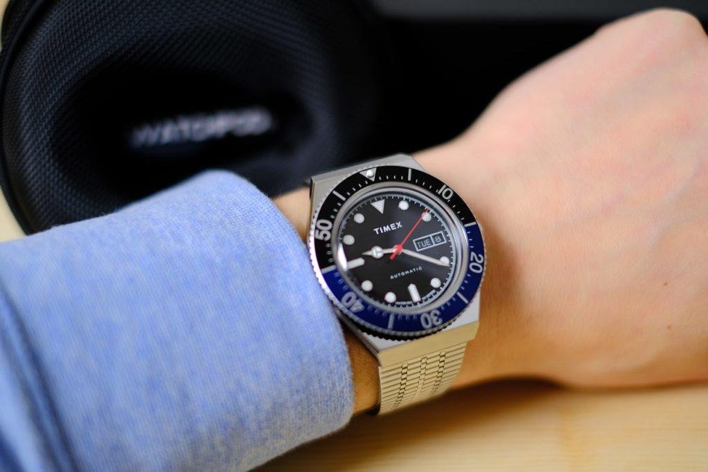 Timex on wrist watchpod background