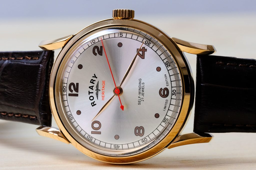 Watch on side with red second hand