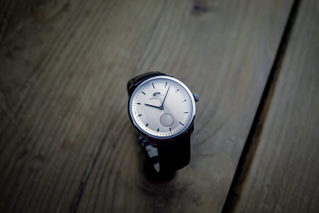 Watch with wood background