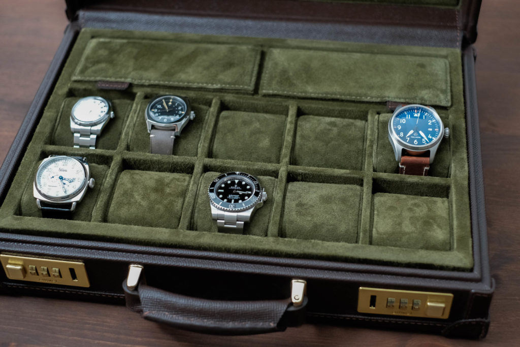 Entire interior of display case with watches