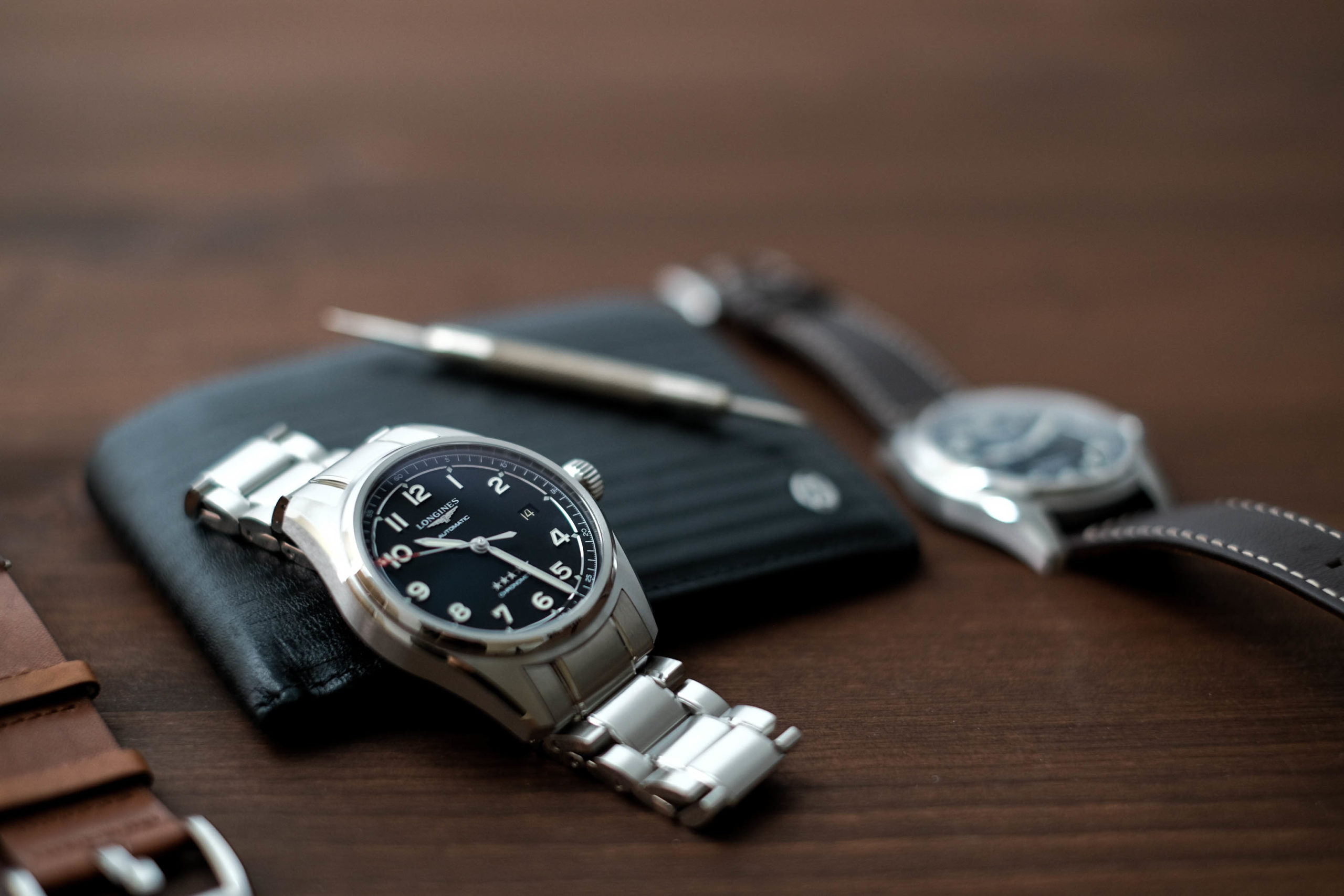 Watch with tool and wallet